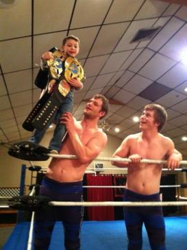 The NCW Tag Team Champions hanging out with a fan