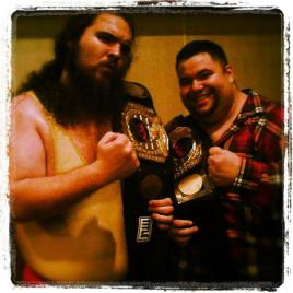 The Big Lovable Team after winning the NCW Tag Team Championship (2012)