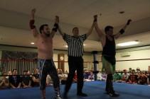 "Paiva and ""RIOT"" Kellan Thomas celebrate at NCW Total Elimination (Sept 2014)"