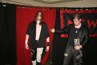 """A young Tim Lennox and Sean Feeney prepare to follow Maniacally Twisted and """"The Maniacal"""" Jack Krueger,"""