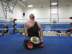"In disbelief, Dean ""The Beast"" Livsley holds his first Championship belt."