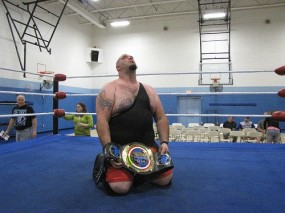 """In disbelief, Dean """"The Beast"""" Livsley holds his first Championship belt."""