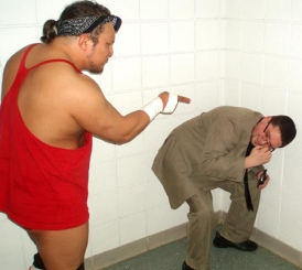 Chris Venom admonishes his former manager JC Marxxx in the locker room.